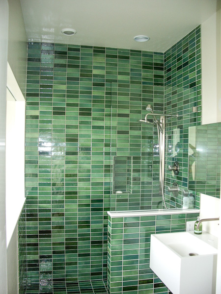 2x6 green Heath tile shower surround with pony wall and recessed niche highlighting color variation in a single glaze