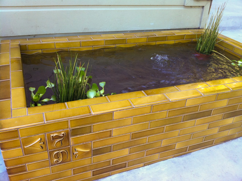 2x8 Heath tile exterior planter/pond with bullnose trimmers and number and arrow detail tiles