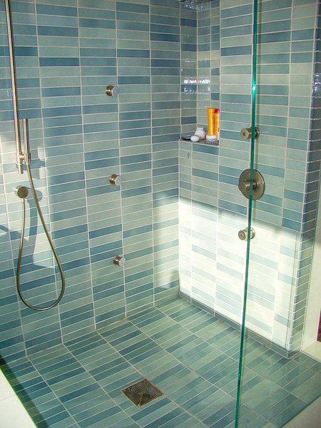 2x9 Crystal Blue Heath tile master bath shower surround with recessed niche, highlighting color variation in a single glaze