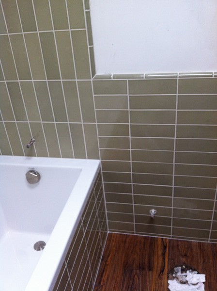 3x9 Heath tile 'stacked' pattern with 1/4 rd trimmers in tub surround/wainscot installation