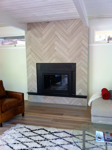 4x18 harringbone pattern limestone fireplace facade surrounding gas insert unit