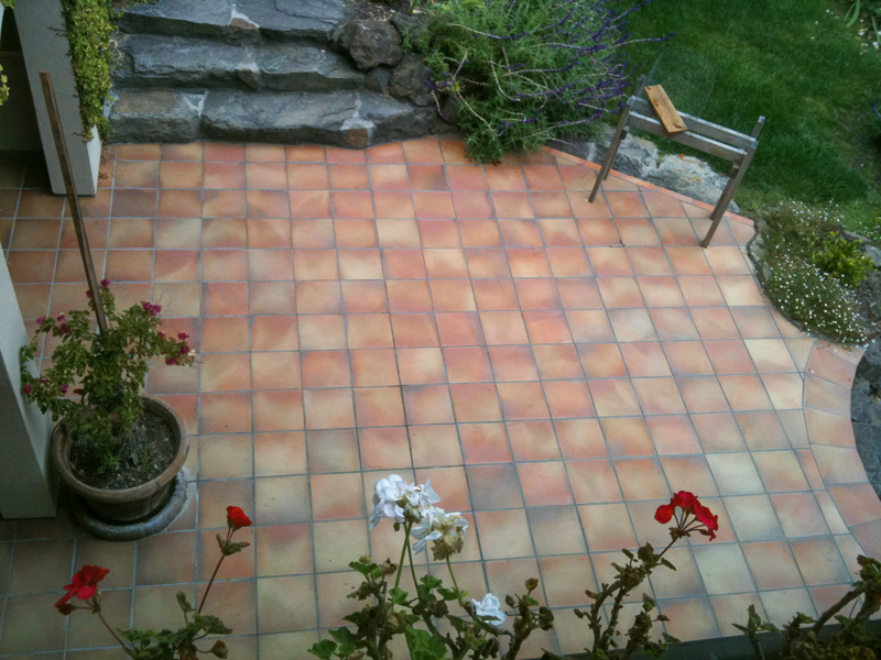 Custom spanish paver patio with scribe border and arch details