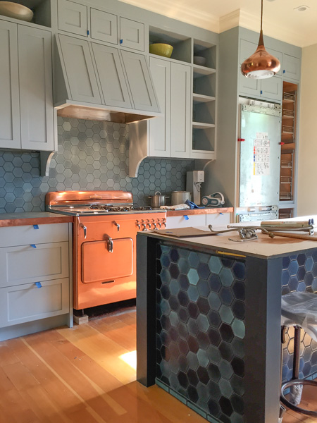 Heath hex kitchen backsplash and center cook island installation highlighting glaze variation