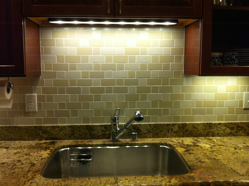 multi-colored, horizontal 2x2 and 2x4 Heath tiles set in 'flemish bond' in kitchen backsplash