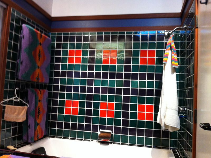 multiple colored 4x4 ceramic tile tub surround with contrasting grout and redwood trim detailing