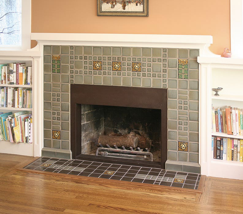 multiple size ceramic tile fireplace surround and hearth with deco details and cast concrete trim